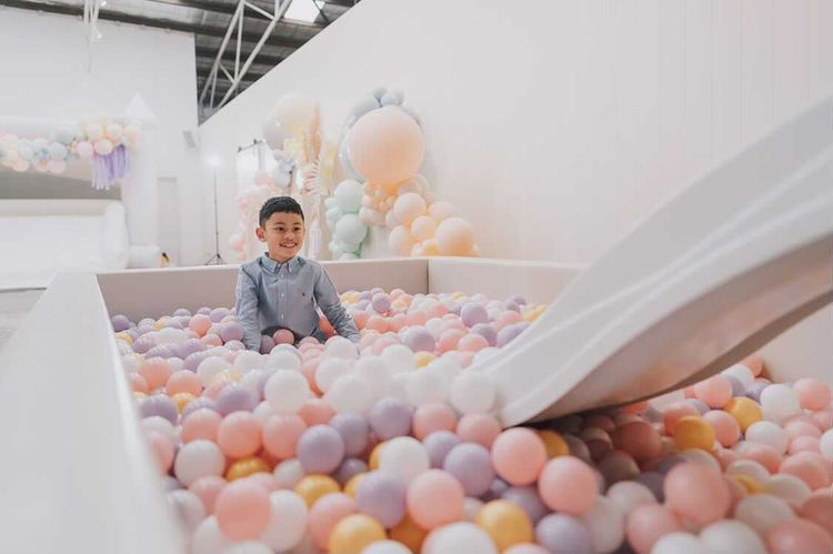 White ball pit with white slide